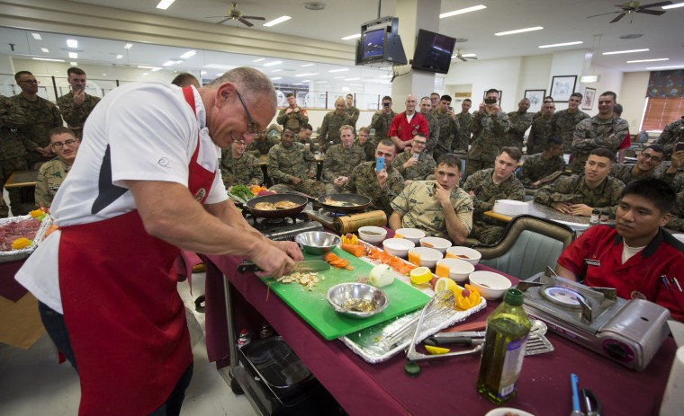 "Chef Robert Irvine gives a cooking demo to US Marine cooks as part of a USO tour stop at Camp Schwab in Okinawa, Japan on January 7, 2014. Irvine, who stars in the Food Network show ""Restaurant Impossible"" will be giving cooking demos and visiting with troops Jan 5-8. (USO Photo/Fred Greaves)"